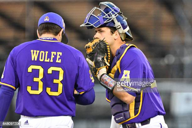 East Carolina catcher Travis Watkins talks with East Carolina pitcher Jacob Wolfe in a game between the St Johns Red Storm and the East Carolina...