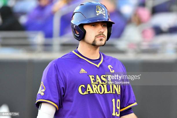 East Carolina catcher Travis Watkins walks back from home plate in a game between the St Johns Red Storm and the East Carolina Pirates during the...