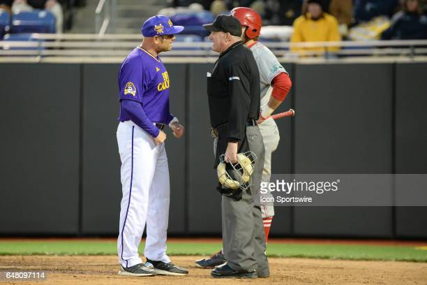 East Carolina head coach Cliff Godwin argues a call with home plate Umpire in a game between the St Johns Red Storm and the East Carolina Pirates...