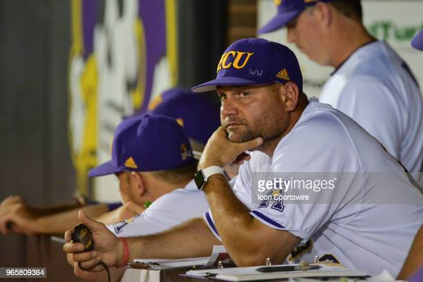 East Carolina head coach Cliff Godwin watches play from the dugout during the NCAA Baseball Greenville Regional between the East Carolina Pirates and...