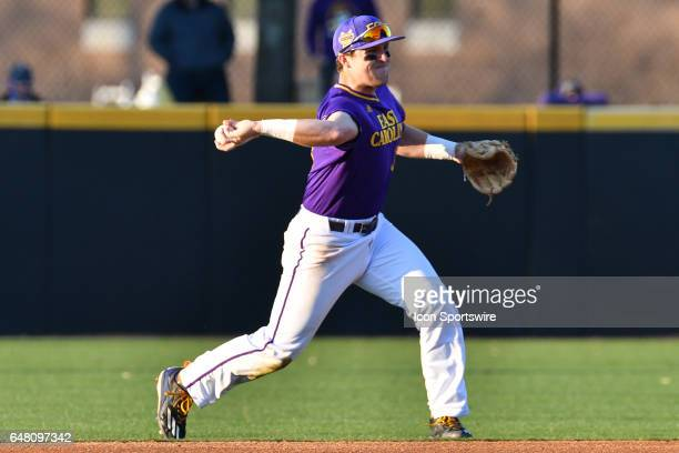 East Carolina infielder Charlie Yorgen throws to first after fielding the ball in a game between the St Johns Red Storm and the East Carolina Pirates...