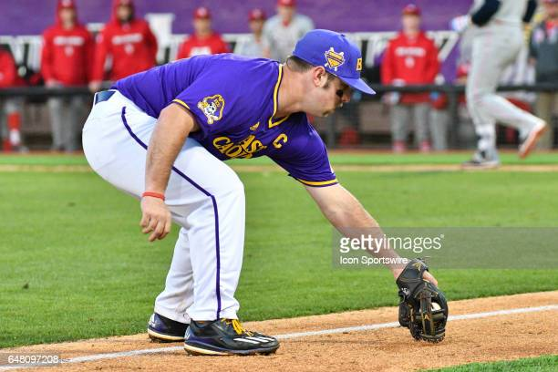 East Carolina infielder Eric Tyler fields a ball in foul territory in a game between the St Johns Red Storm and the East Carolina Pirates during the...