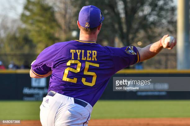 East Carolina infielder Eric Tyler throws to second for an out in a game between the St Johns Red Storm and the East Carolina Pirates during the...