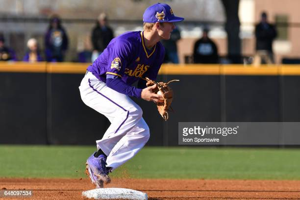 East Carolina infielder Turner Brown tags a runner out at second base and prepares to throw to third in a game between the St Johns Red Storm and the...