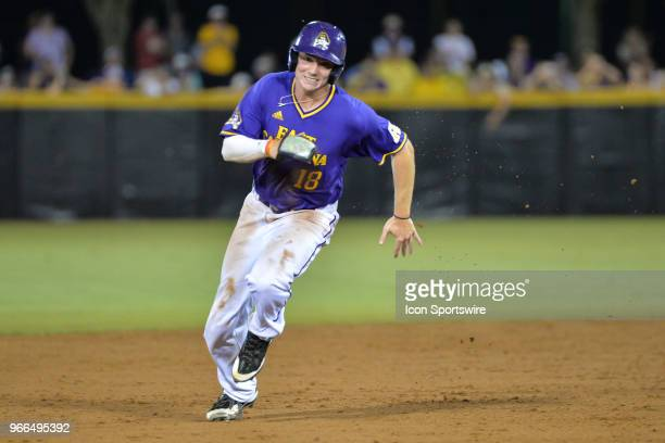 East Carolina outfielder Bryant Packard rounds second during the NCAA Baseball Greenville Regional between the East Carolina Pirates and the South...