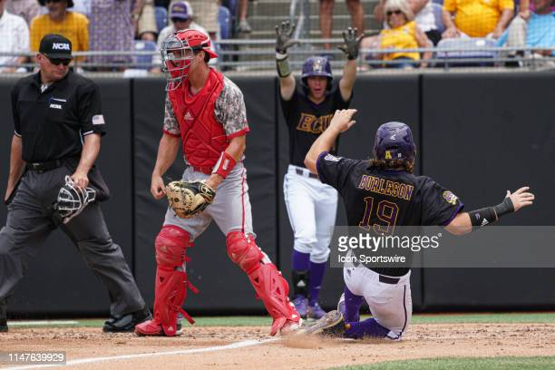 East Carolina Pirates Alec Burleson slides into home in front of North Carolina State Wolfpack catcher Patrick Bailey during a game between the East...