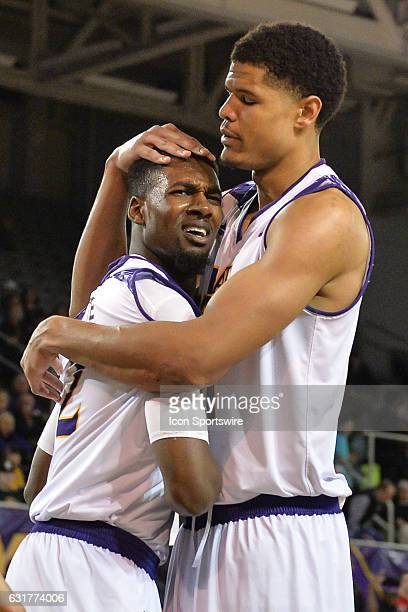East Carolina Pirates center Andre Washington comforts East Carolina Pirates guard Caleb White in an American Athletic Conference game between the...
