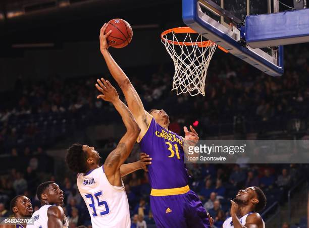 East Carolina Pirates Center Andre Washington gets in behind the Tulsa defense to score during the AAC Mens basketball game between the East Carolina...
