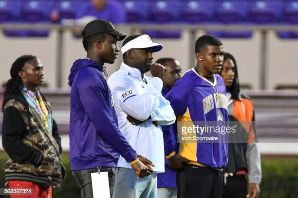 East Carolina Pirates defensive back commit Nolan Johnson stands to the left of East Carolina Pirates head coach Scottie Montgomery during a game...