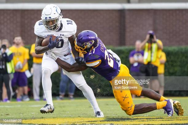 East Carolina Pirates defensive back Daniel Charles tackles Old Dominion Monarchs wide receiver Darrell Brown during a game between the Old Dominion...