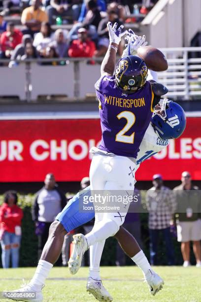 East Carolina Pirates defensive back Michael Witherspoon breaks up a pass intended for Memphis Tigers wide receiver Damonte Coxie during a game...