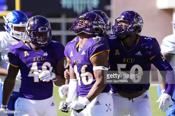 East Carolina Pirates defensive end Chance Purvis celebrates after tackling Memphis Tigers running back Darrell Henderson during a game between the...
