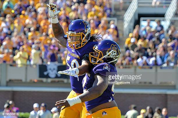 East Carolina Pirates defensive lineman Shaun James and East Carolina Pirates defensive lineman Mike Myers celebrate in a game between the East...