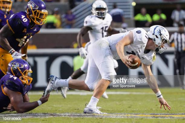 East Carolina Pirates defensive tackle Alex Turner sacks Old Dominion Monarchs quarterback Blake LaRussa by the tip of his toe during a game between...