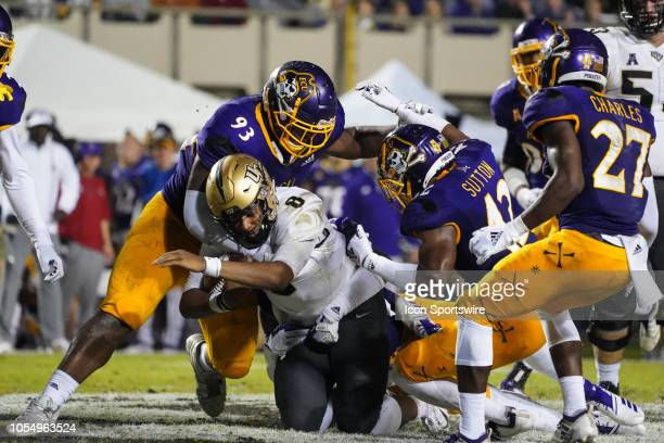 East Carolina Pirates defensive tackle Jalen Price teams up to make a tackle on UCF Knights quarterback Darriel Mack Jr during a game between the UCF...