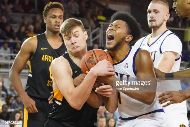 East Carolina Pirates forward Jayden Gardner and Appalachian State Mountaineers forward Hunter Seacat battle for a rebound during a game between the...