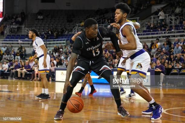 East Carolina Pirates forward Jayden Gardner defends as Cincinnati Bearcats forward Tre Scott drives to the basket during a game between the...