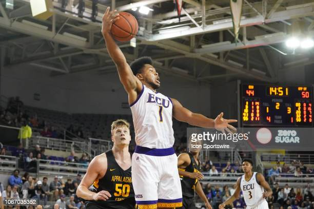 East Carolina Pirates forward Jayden Gardner grabs a rebound over Appalachian State Mountaineers forward Hunter Seacat during a game between the East...