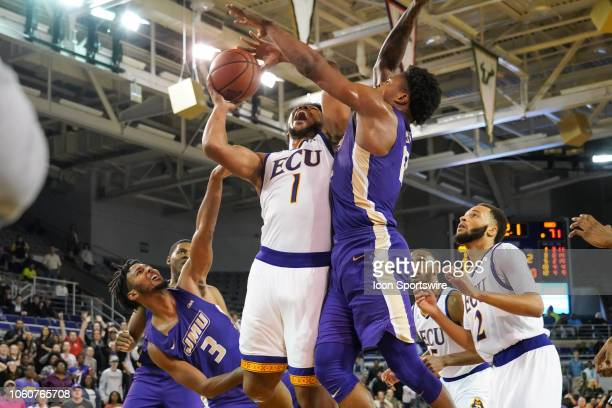 East Carolina Pirates forward Jayden Gardner is fouled by James Madison Dukes guard Stuckey Mosley driving to the basket during a game between the...
