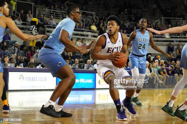 East Carolina Pirates forward Jayden Gardner picks up his dribble in front of Tulane Green Wave forward Blake Paul during a game between the East...