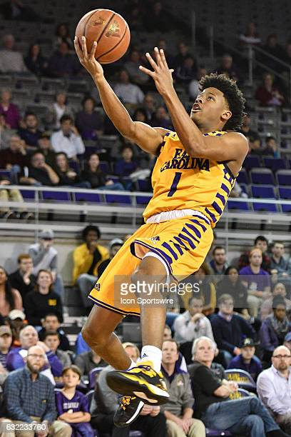 East Carolina Pirates guard Elijah Hughes drives to the basket in an American Athletic Conference game between the East Carolina Pirates and the...