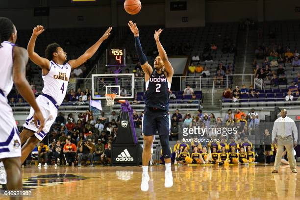 East Carolina Pirates guard Elijah Hughes guards Connecticut Huskies guard Jalen Adams on a three point attempt in a game between the Connecticut...