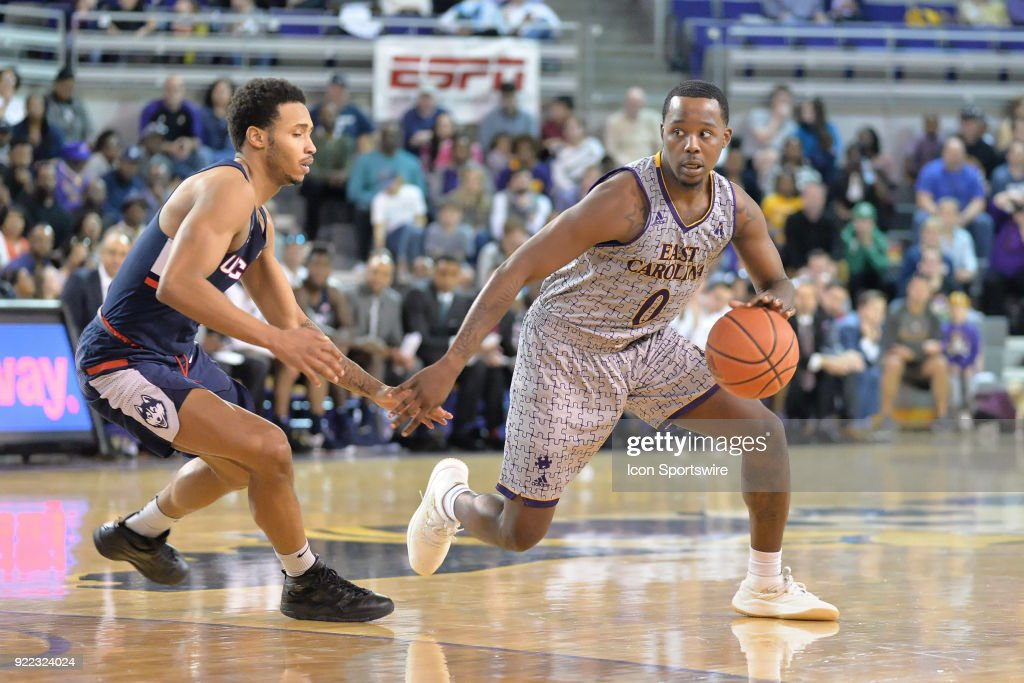 East Carolina Pirates guard Isaac Fleming (0) dribbles around Connecticut Huskies guard Jalen Adams (4) during a game between the ECU Pirates and the UConn Huskies at Williams Arena - Minges Coliseum in Greenville, NC on February 18, 2018.