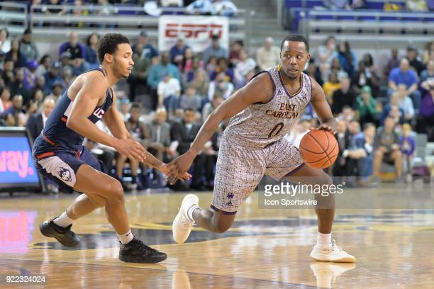 East Carolina Pirates guard Isaac Fleming dribbles around Connecticut Huskies guard Jalen Adams during a game between the ECU Pirates and the UConn...