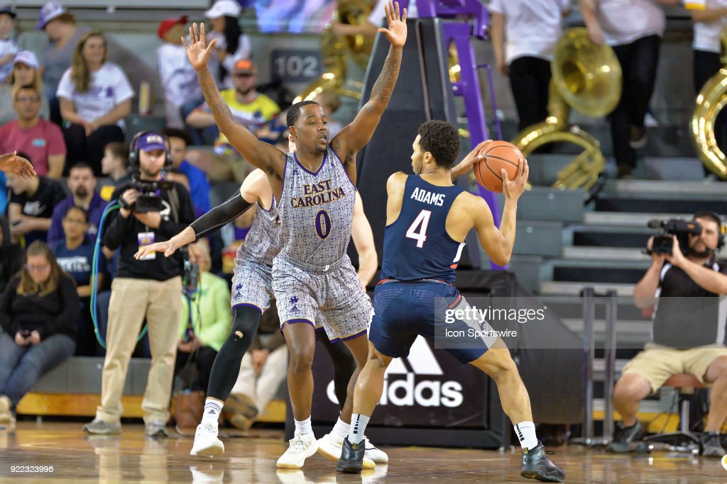 East Carolina Pirates guard Isaac Fleming (0) guards Connecticut Huskies guard Jalen Adams (4) during a game between the ECU Pirates and the UConn Huskies at Williams Arena - Minges Coliseum in Greenville, NC on February 18, 2018.