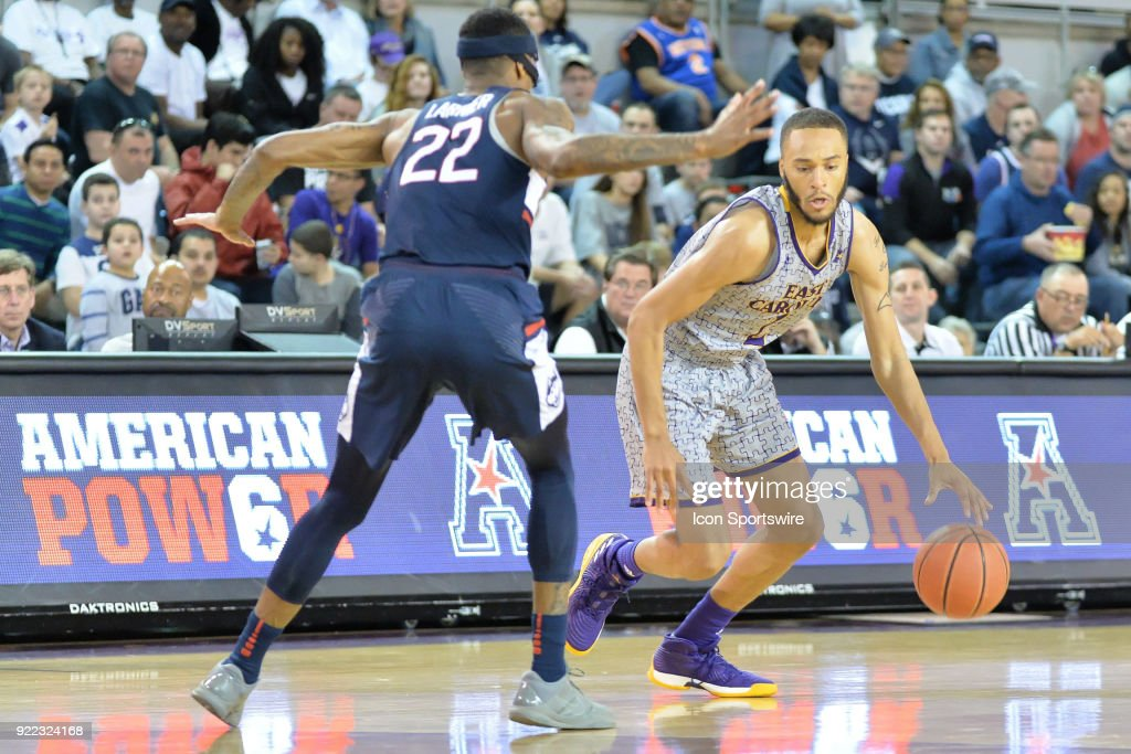 East Carolina Pirates guard K.J. Davis (2) prepares to dribble around Connecticut Huskies guard Terry Larrier (22) during a game between the ECU Pirates and the UConn Huskies at Williams Arena - Minges Coliseum in Greenville, NC on February 18, 2018.