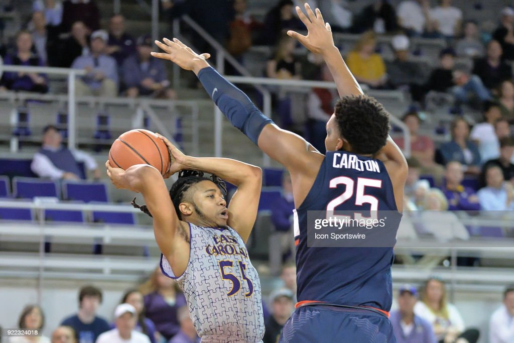 East Carolina Pirates guard Shawn Williams (55) attempts to pass the ball away from Connecticut Huskies forward Josh Carlton (25) during a game between the ECU Pirates and the UConn Huskies at Williams Arena - Minges Coliseum in Greenville, NC on February 18, 2018.