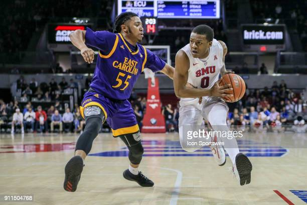 East Carolina Pirates guard Shawn Williams guards Southern Methodist Mustangs guard Jahmal McMurray during the game between SMU and East Carolina on...