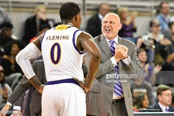 East Carolina Pirates head coach Jeff Lebo coaches East Carolina Pirates guard Isaac Fleming in a timeout during a game between the Radford...