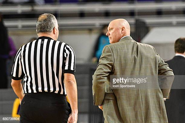East Carolina Pirates head coach Jeff Lebo has a heated discussion with referee Jose Carrion in an American Conference regular season game between...