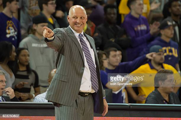 East Carolina Pirates head coach Jeff Lebo is smiling during an NCAA Men's Basketball game between the East Carolina Pirates and the NC AT Aggies at...