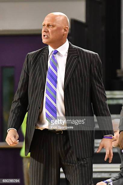 East Carolina Pirates head coach Jeff Lebo paces the sideline in a NCAA Basketball game between the East Carolina Pirates and the Charleston Cougars...