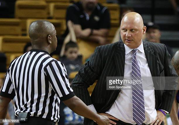 East Carolina Pirates head coach Jeff Lebo talks with the referee during an injury timeout in the mens basketball game between the UCF Knights and...