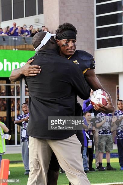 East Carolina Pirates head coach Scottie Montgomery and East Carolina Pirates wide receiver Zay Jones embrace before an NCAA football game between...