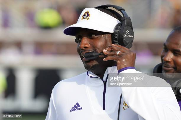 East Carolina Pirates head coach Scottie Montgomery calls a play during a game between the East Carolina Pirates and the North Carolina Tar Heels at...