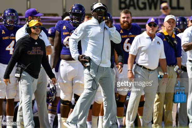 East Carolina Pirates head coach Scottie Montgomery calls a play during a game between the South Florida Bulls and the East Carolina Pirates at...