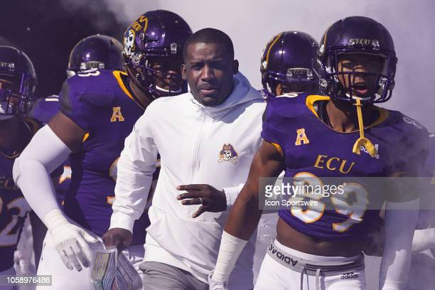 East Carolina Pirates head coach Scottie Montgomery takes the field during a game between the Memphis Tigers and the East Carolina Pirates at...