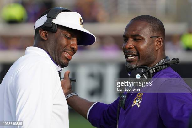 East Carolina Pirates head coach Scottie Montgomery talks with assistant coach Keith Gaither during a game between the East Carolina Pirates and the...