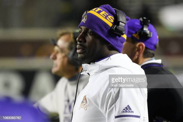 East Carolina Pirates head coach Scottie Montgomery watches play during a game between the UConn Huskies and the East Carolina Pirates at...