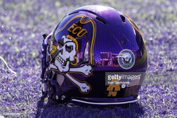 East Carolina Pirates helmet sits on the field on Military Appreciation Day during a game between the Memphis Tigers and the East Carolina Pirates at...