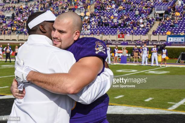 East Carolina Pirates linebacker Anthony Gutierrez with East Carolina Pirates head coach Scottie Montgomery during pregame senior activities during a...