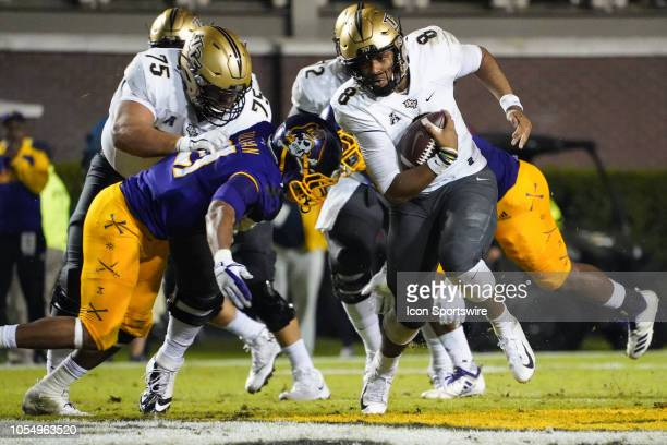 East Carolina Pirates linebacker Ray Tillman dives to make a tackle on UCF Knights quarterback Darriel Mack Jr during a game between the UCF Knights...