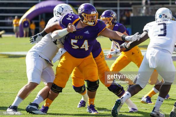 East Carolina Pirates offensive lineman Branden Pena is held as he tries to tackle Old Dominion Monarchs running back Gemonta Jackson during a game...