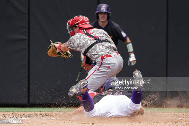 East Carolina Pirates outfielder Chandler Jenkins sides into home ahead of a tag by North Carolina State Wolfpack catcher Patrick Bailey during a...