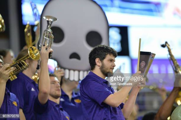 East Carolina Pirates pep band member plays gives more cow bell during a game between the Southern Methodist University Mustangs and the East...