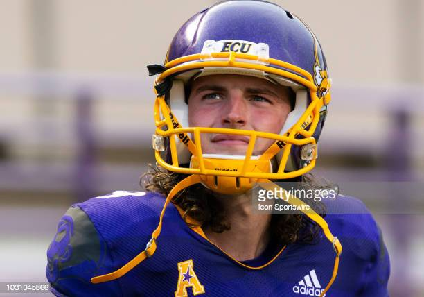 East Carolina Pirates place kicker punter Jake Verity looks at the scoreboard during a game between the North Carolina Tar Heels and the East...